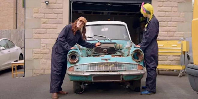 Cherry and her friend restoring the Ford Anglia