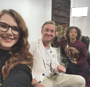 Tom Felton and Cherry Wallis with Yinka Bokinni in the 'Back To Hogwarts' livestream.