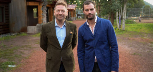 Sir Kenneth Branagh and Jamie Dornan standing on the set of Belfast.