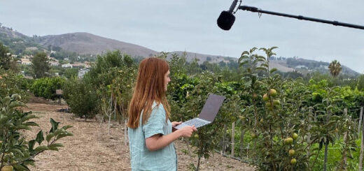Bonnie Wright in an orchard recording.